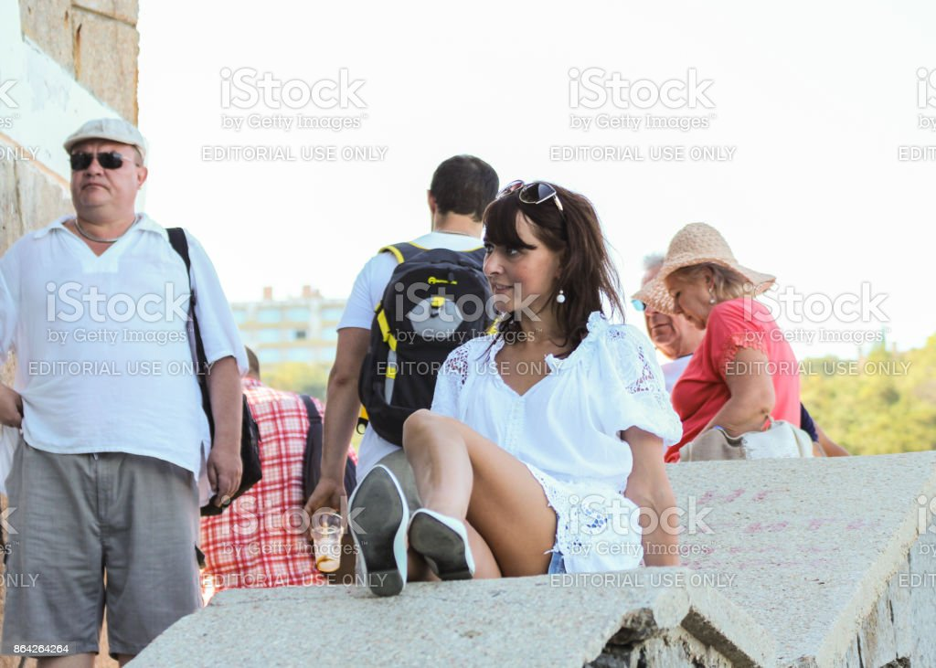The girl is posing on the stairs parapet. royalty-free stock photo