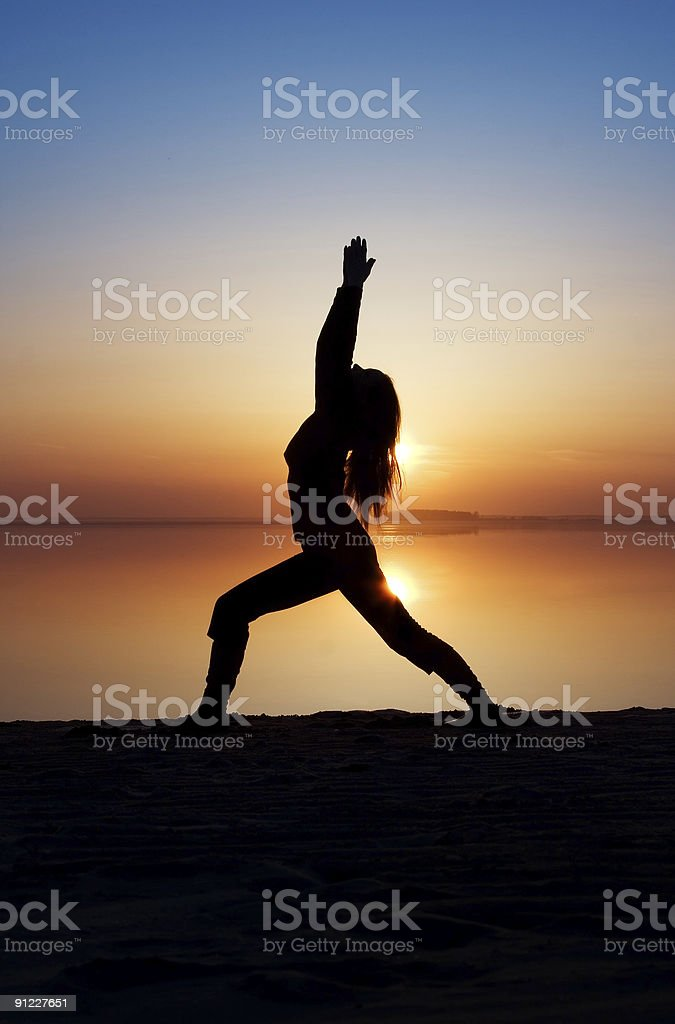 The girl is practising yoga. royalty-free stock photo