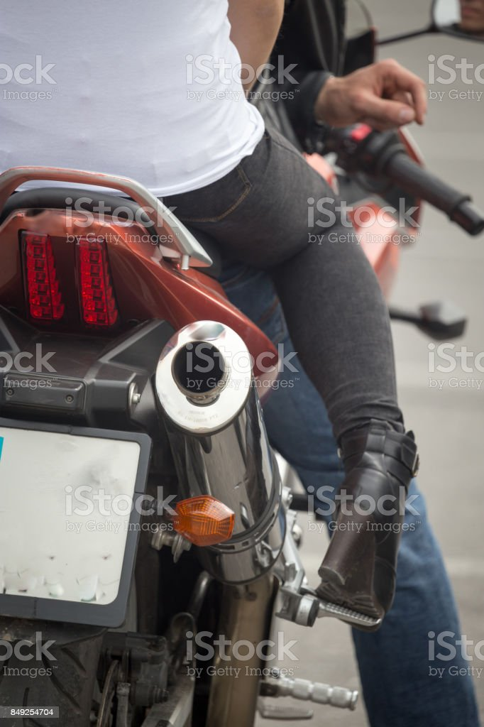 The girl is sitting on a motorcycle stock photo