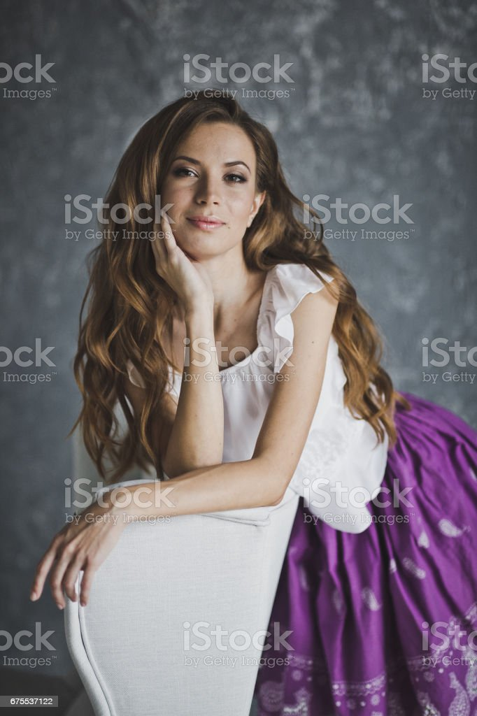 The girl leaned a hand on the white chair 6925. royalty-free stock photo