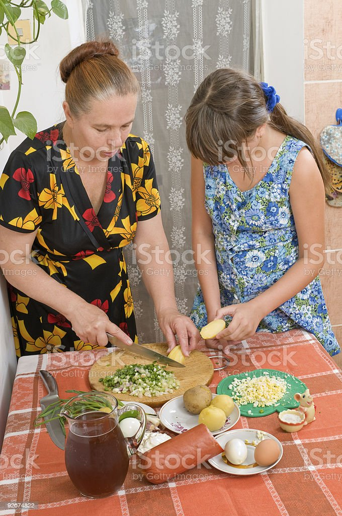 The girl learns to cook a dinner royalty-free stock photo