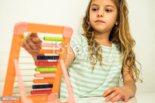 istock the girl learns to count on the abacus 935728922