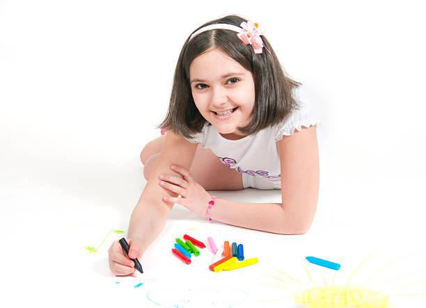 The girl lying draws white background stock photo