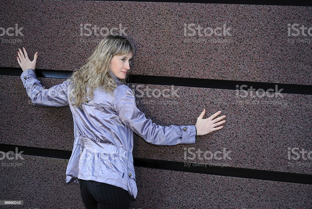 The girl near a wall royalty-free stock photo