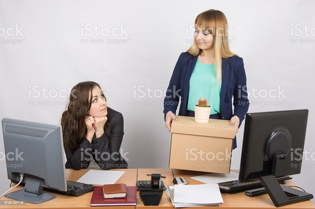 The girl office happily holding bags and looking at colleague stock photo