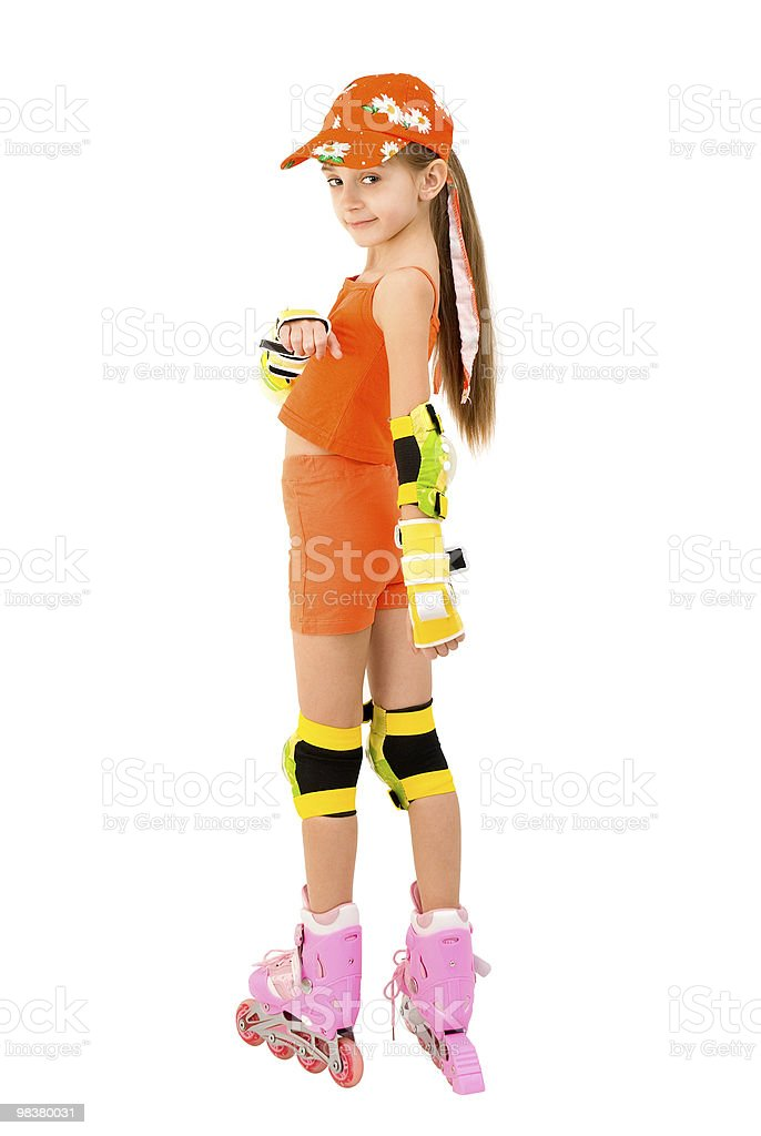 The girl on roller skates royalty-free stock photo