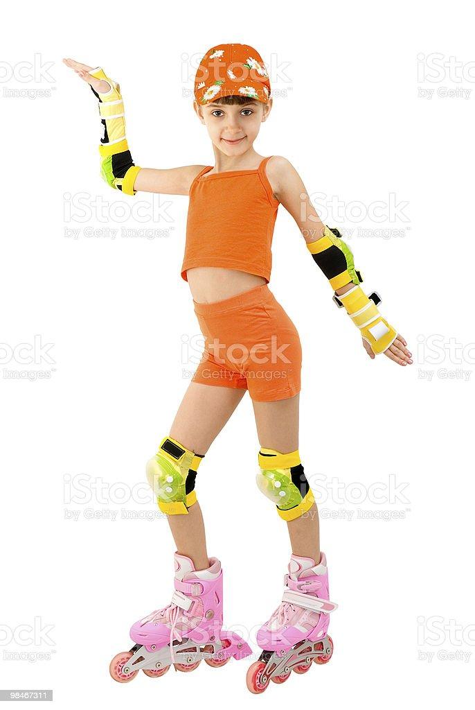 The girl on roller skates royalty-free stock photo