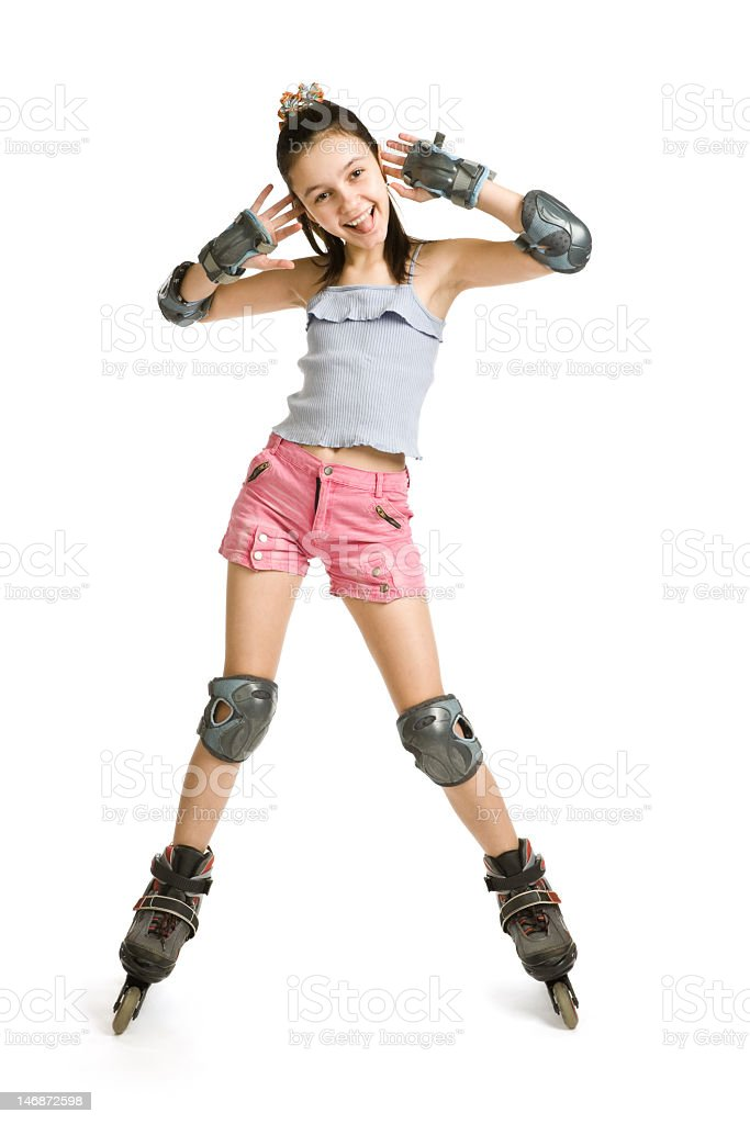 The girl on rollers pulls a face stock photo