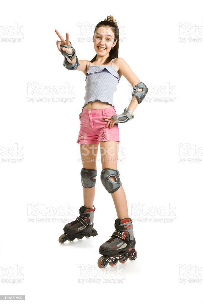 The girl on rollers shows a victory sign stock photo