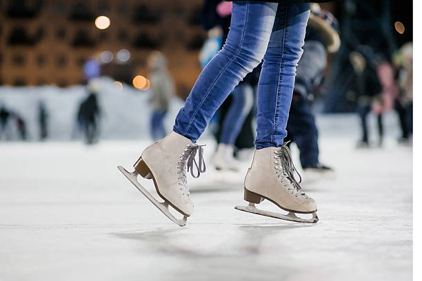 The girl on the figured skates Girl on the figured skates at opened skating rink. Russia. ice skating stock pictures, royalty-free photos & images