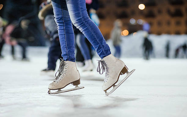 the girl on the figured skates the girl on the figured skates on a skating rink ice skating stock pictures, royalty-free photos & images