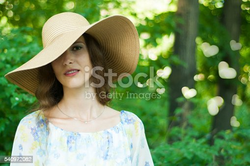624717328istockphoto The girl on the sun in a hat 540972082