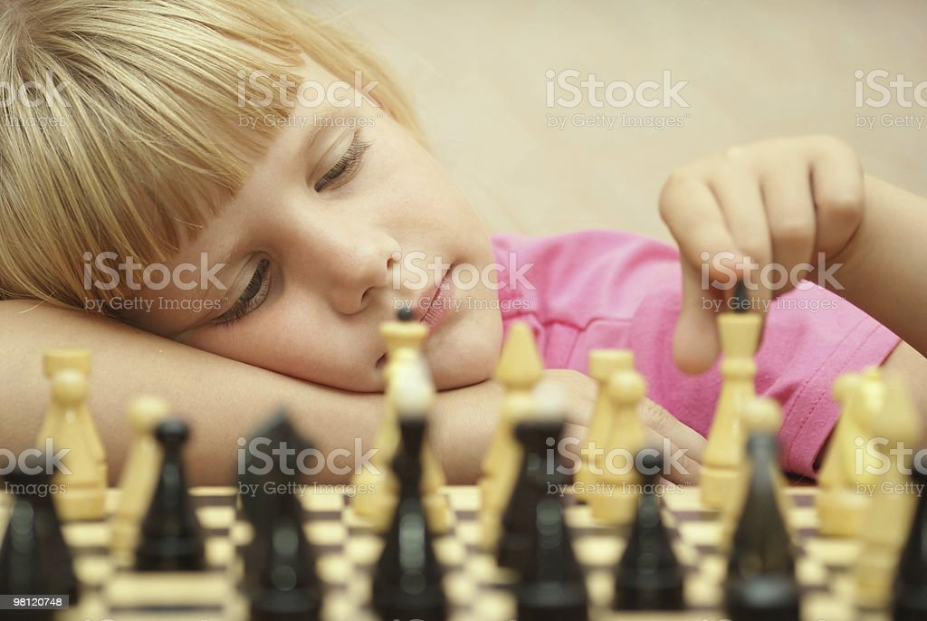 The girl plays chess royalty-free stock photo