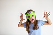 The girl plays in a self-made mask of Frankenstein for Halloween
