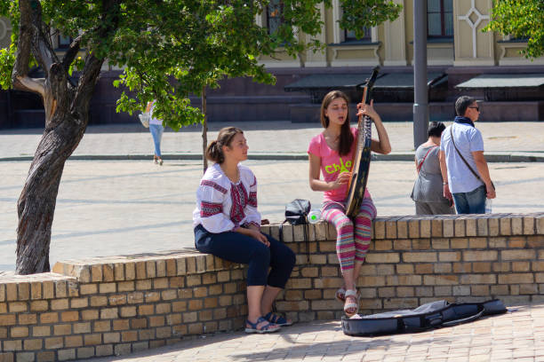 Cтоковое фото The girl plays the folk instrument of the bandura on the town square