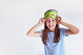 Girl plays the fool in a mask  monster for Halloween Smile Happiness Game Fun Holiday