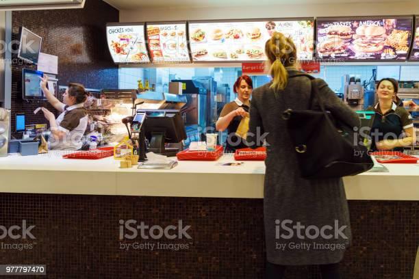 The girl receives an order in the interior of the mcdonalds munich picture id977797470?b=1&k=6&m=977797470&s=612x612&h=rch4u1qyyldjlvx9eo zgjj16ewsu0bx8jekiff4fvi=