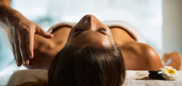 The girl relaxes in the spa and gets massage stock photo