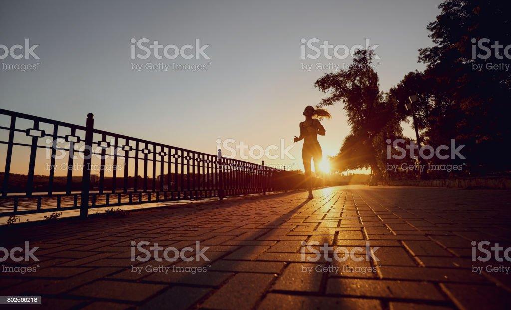 The girl runs in park. stock photo
