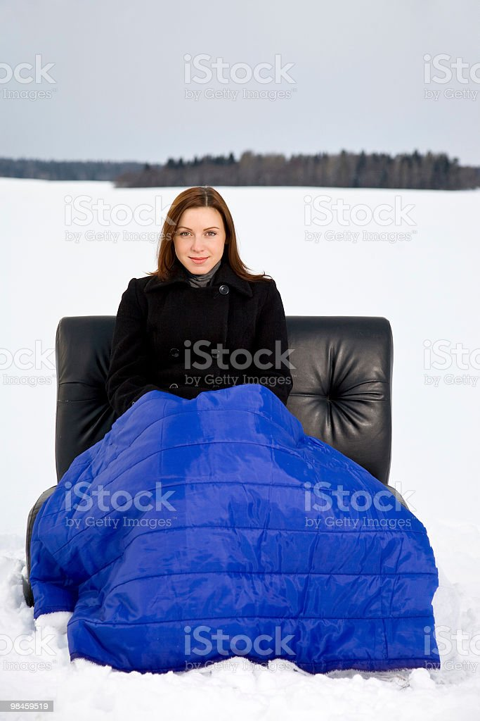 The girl sits in an armchair royalty-free stock photo