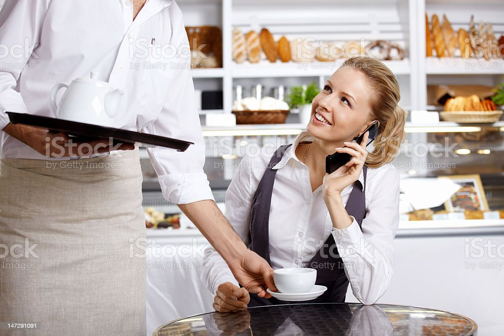 The girl speaks by phone in cafe royalty-free stock photo