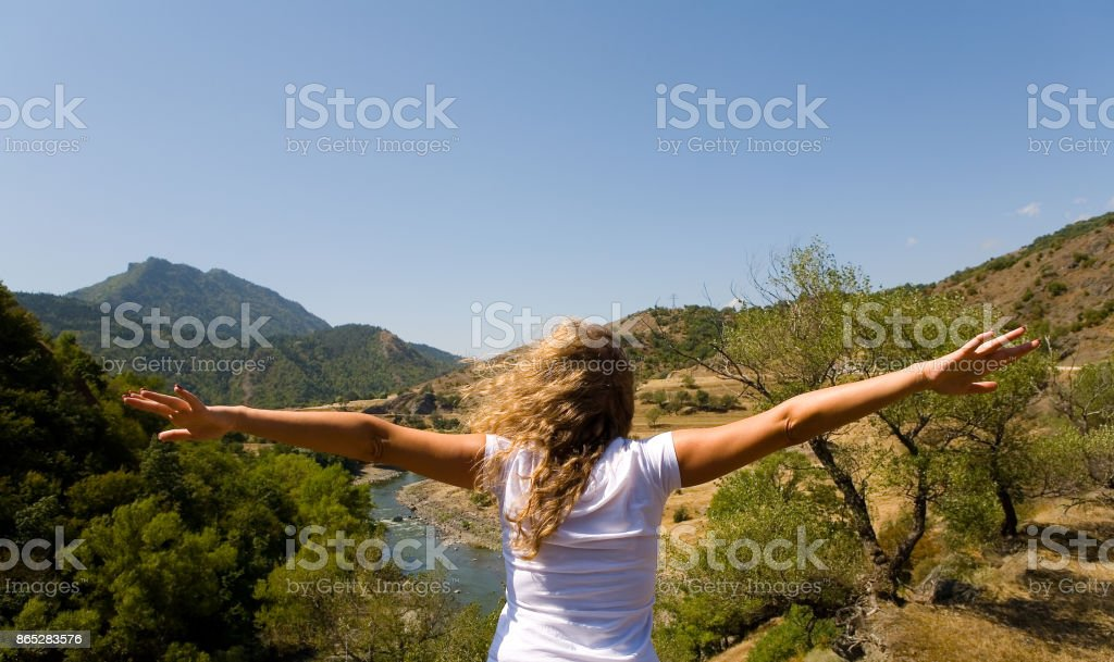 The girl spread her arms like a bird's snout. stock photo