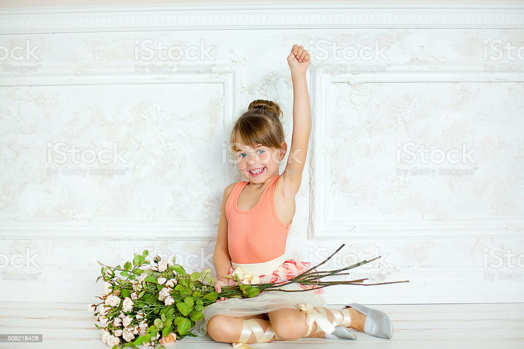 the girl the ballerina with flowers stock photo