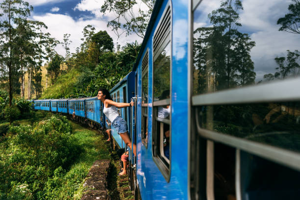The girl travels by train to beautiful places. Beautiful girl traveling by train among mountains. Travel by train. Travelling to Asia. Trains Sri Lanka. Railway transport. Railway. Transport Asia The girl travels by train to beautiful places. Beautiful girl traveling by train among mountains. Travel by train. Travelling to Asia. Trains Sri Lanka. Railway transport. Railway. Transport Asia goa stock pictures, royalty-free photos & images