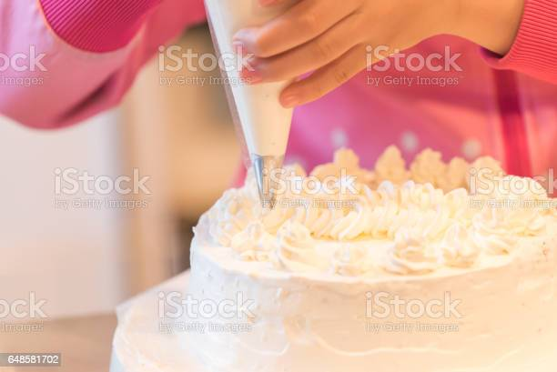 The Girl Who Makes A Cake Stock Photo - Download Image Now