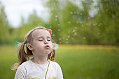 the girl with a dandelion outdoor