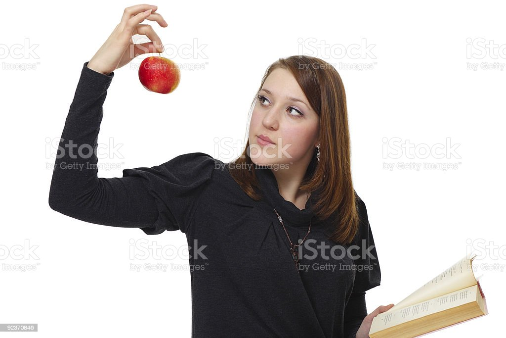 The girl with book and an apple royalty-free stock photo