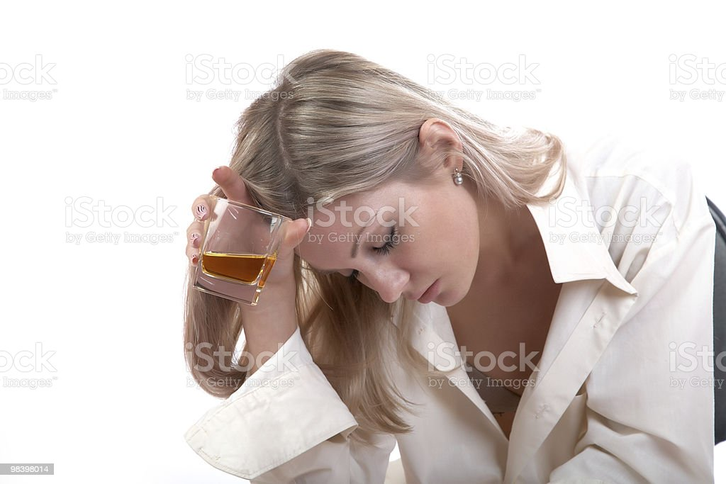The girl with  glass of whisky royalty-free stock photo