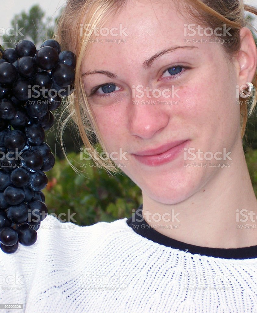 The girl with grape-color eyes royalty-free stock photo