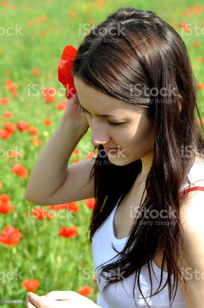The girl with poppy flower royalty-free stock photo