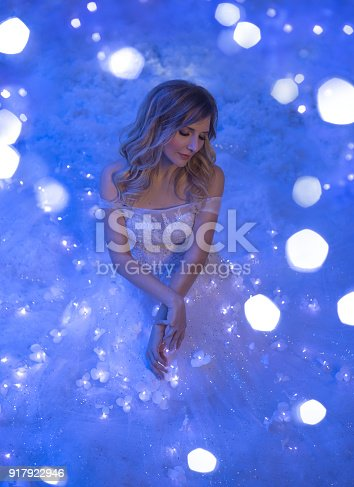 891402486 istock photo The girl woke up on Christmas night and in her room a miracle turned, magic turned her into a fairy princess. 917922946