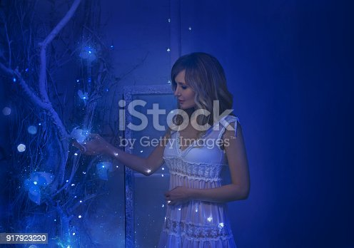 891402486 istock photo The girl woke up on Christmas night and in her room a miracle turned, magic turned her into a fairy princess. 917923220