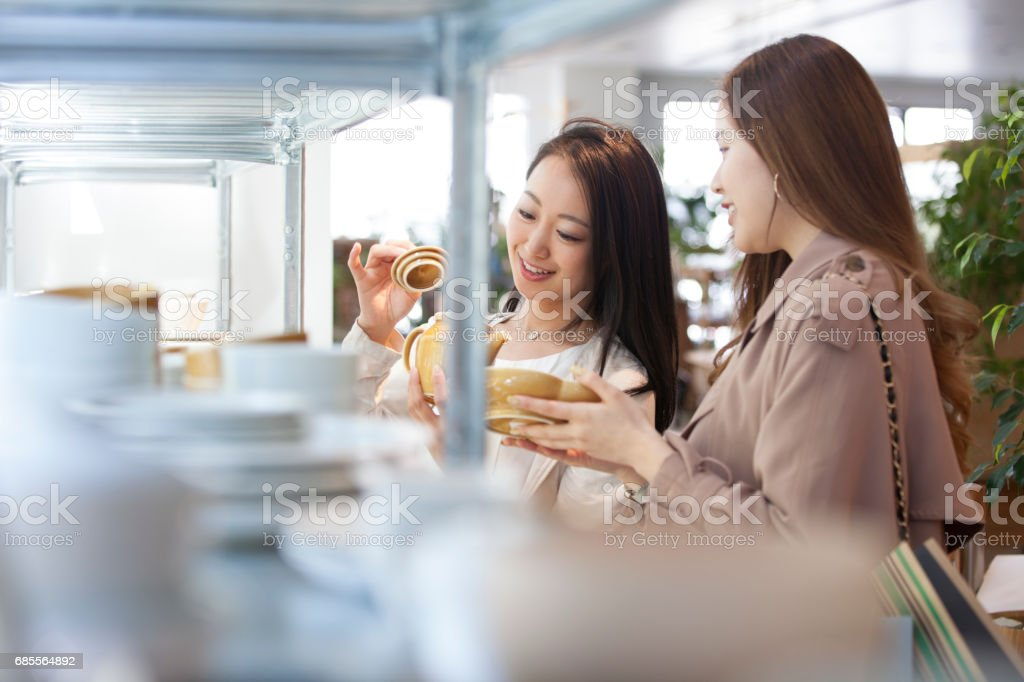 The girls choosing the dish plate. stock photo