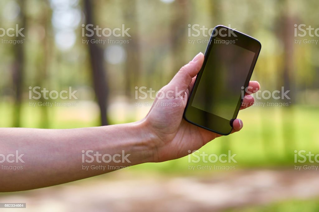 the girl's hand holds a mobile phone for communication foto stock royalty-free