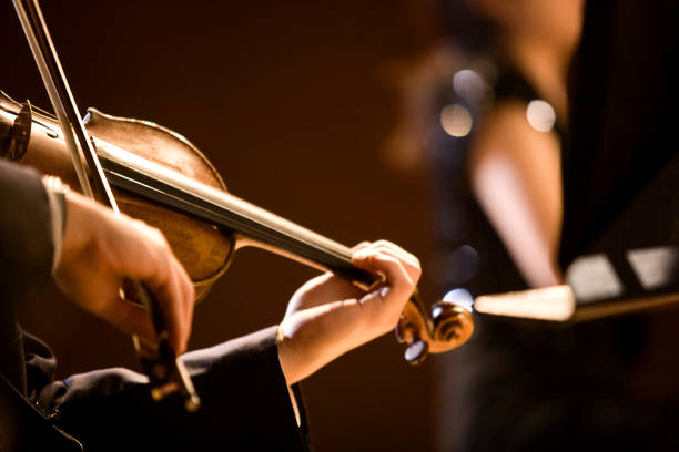 the girl's hand on the strings of a violin - arts culture and entertainment stock pictures, royalty-free photos & images