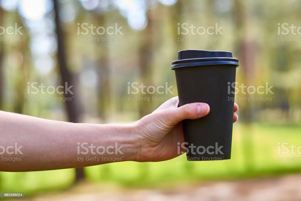 the girl's hand reaches for a Cup of morning coffee for energy foto de stock libre de derechos