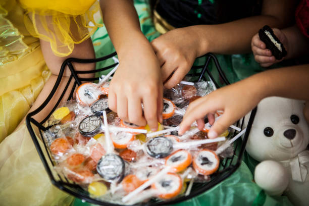 The girls in the costume of princess have chosen which Lollipop to eat. The girls have chosen from among many lollipops. trick or treat stock pictures, royalty-free photos & images