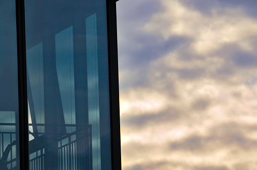 The glass curtain wall of the building in sunrise