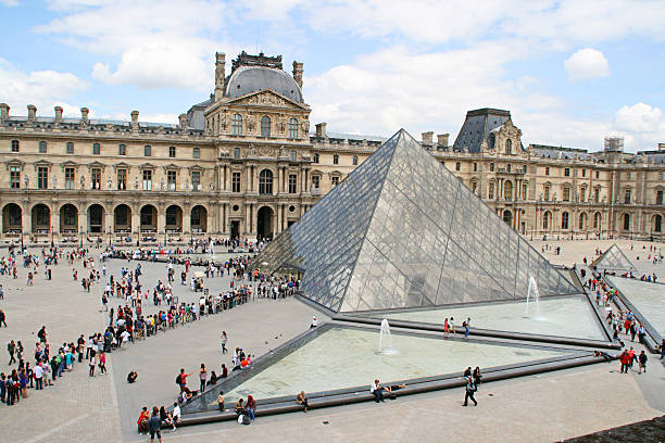 The glass pyramid of the Louvre Paris, France - June 23, 2012: musee du louvre stock pictures, royalty-free photos & images