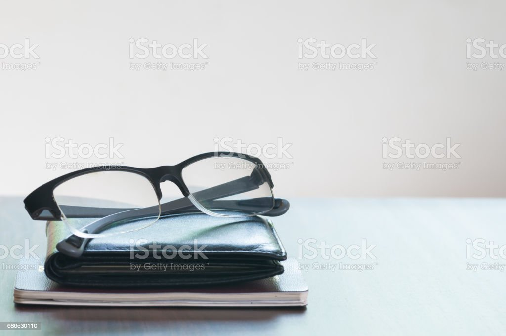 The glasses and wallet and passport isolated on the wooded table royalty free stockfoto