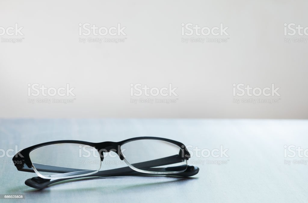 The glasses isolated on the wooded table zbiór zdjęć royalty-free