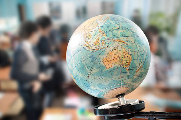 the globe during geography class stock photo