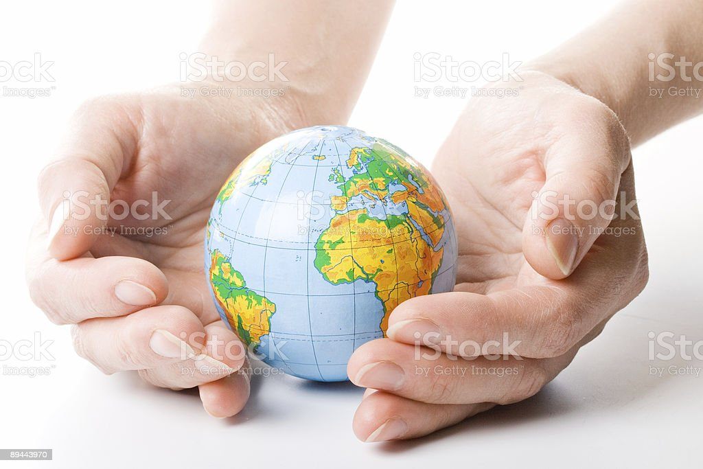 The globe in hands royalty-free stock photo