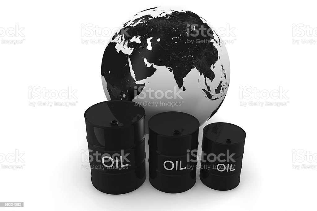 The globe of the earth and oil barrels royalty-free stock photo