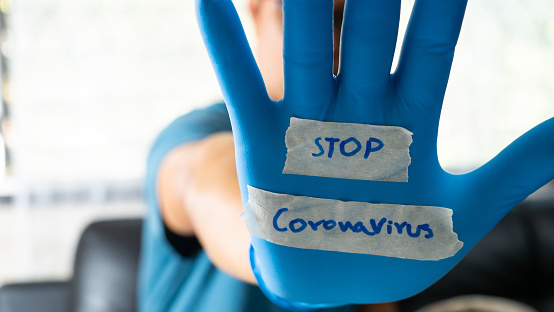 istock The glove-wearer has a message to stop the Coronavirus 1202181405