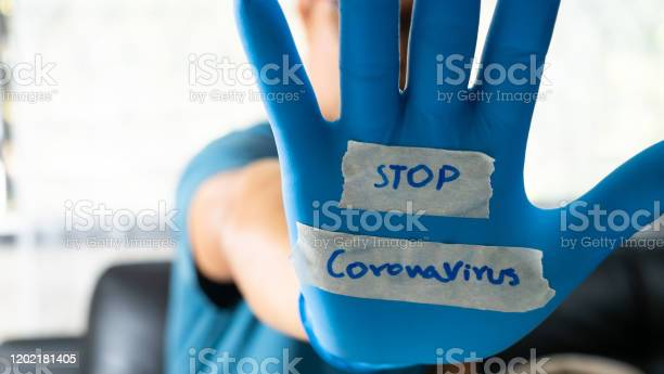 The glovewearer has a message to stop the coronavirus picture id1202181405?b=1&k=6&m=1202181405&s=612x612&h=a07lcvo 7ohbjfuc4fz x quehoklqbx1c6xetzoii8=